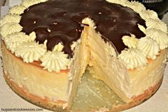 Boston Cream Pie Cheesecake.  It starts with a sponge cake layer and Junior's Cheesecake recipe, topped with a scrumptious pastry cream and then a nice chocolate layer. Mmmmm!!!