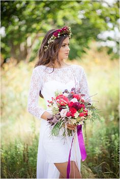Bride holding cranberry and red fall wedding bouquet - Dress by A.M.E.G. Designs