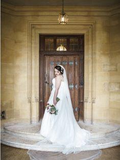 Long bridal veil and ivory dress