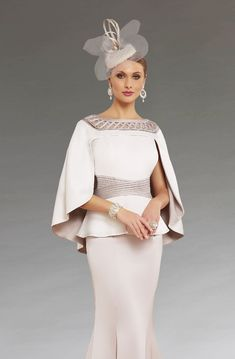 This full length dress features a peplum style waistband that creates a more flattering silhouette. The matching cape drapes elegantly over the shoulders. This dress is also available in a knee length version. Mother Of The Bride Fashion, Mother Of Bride Outfits, Mother Of Groom Dresses, Mothers Dresses, Mob Dresses, Bridal Dresses, Fashion Dresses, Prom Outfits, Classy Outfits