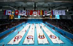 (EDITORS NOTE: Image was created using a variable planed lens) A general view of the action in the men's round robin session during day four of the Sochi 2014 Winter Olympics at Ice Cube Curling Center on February 11, 2014 in Sochi, Russia. (Photo by Streeter Lecka/Getty ...