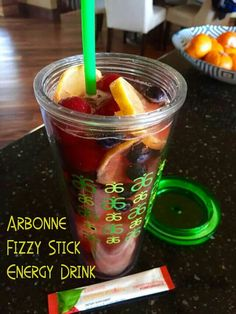 Pick Me Up Energizer Drink made with frozen strawberries, blueberries, sliced lemons, 2 Arbonne Pomegranate Energy Fizz Sticks and 16 oz. filtered water.  To order visit http://SusanSakys.Arbonne.com  - Susan Sakys, Independent Arbonne Consultant