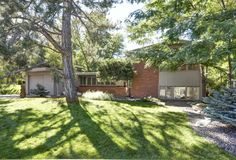Mid-Century Modern in Historic Arapahoe Acres. Walls of glass and brick. Wonderful inside/outside connection.