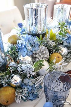 Learn how to create these elegant fall table settings with a blue and white color palette using white dishes, blue and white chinoiserie bowls, navy napkins, sparkly mercury glass and a transitional holiday centerpiece accented White Table Settings, Christmas Table Settings, Christmas Tablescapes, Holiday Tables, Holiday Centerpieces, Table Centerpieces, Table Decorations, Easter Centerpiece, Easter Decor