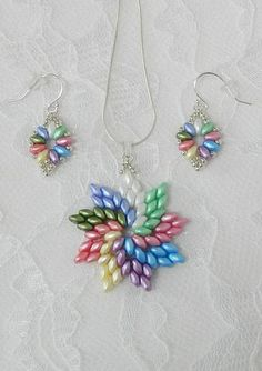 This pretty pendant captures all the colors of Spring! I used Super Duo beads in 9 different colors with Galvanized Silver seed beads as an accent. It hangs on an 18 inch Genuine 925 Sterling Silver Snake Chain. Perfect for the go to necklace that can be worn with anything! MAKE IT A
