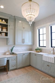 My favorite room in the home was the combination laundry/office space. Of course it was huge but I really fell in love with the cabinetry color, the layout, the tile and the beautiful accents. This is really amazing design work right here
