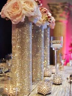 Silver centerpieces -- maybe with peach roses silver centerpiece, wedding centerpieces, wedding decorations Wedding Table, Wedding Reception, Wedding Venues, Wedding Destinations, Silver Centerpiece, Glitter Centerpieces, Centerpiece Ideas, Bling Wedding Centerpieces, Glitter Vases