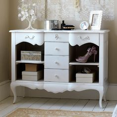 Make a decorative French-style console table the star of a vintage bedroom with a lick of paint. Look for an old mahogany one in junk shops, then paint it white or pale grey and change the handles for a feminine touch. Add glamour with mirrored storage boxes and frames with a floral motif.