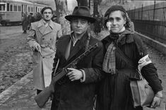 Young couple in Budapest, during the Hungarian Revolution of 1956 [[MORE]] The man with the riffle was 17 years old and got killed by the soviet police 2 hours after this photo was taken. The woman escaped and died in 1990 in Australia. The man with. Vintage Photographs, Vintage Images, Sean Diddy, World Conflicts, Michael Crichton, Young Couples, My Heritage, The Real World, Life Magazine