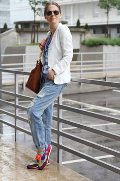 3bea2a7a68e6 white blazer blue jeans colorful sneakers brown shoulder bag. Sunglasses.  Summer women apparel style