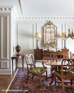 The paint finish in the dining room was selected to enhance the plaster work and molding. The 18th century gilt mirror is from Marshall Clements. The Persian rug is an antique. | Historical Influence | At Home in Arkansas | November 2016