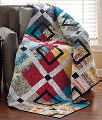 This easy quilt called Snapshot is by Gudrun Erla. she mixes fun fabrics and lots of color for an eye catching quilt that is sure to fit anywhere.