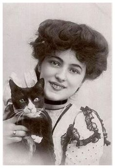 "Evelyn Nesbit, famous as ""The Girl in the Red Velvet Swing,"" and her Tuxedo Cat. Nesbit was a model and actress whose husband, Pittsburg millionaire Harry K. Thaw, shot and killed acclaimed architect Stanford White on the rooftop of Madison Square Garden in 1906. The killing resulted in what was deemed ""The Trial of the Century."""
