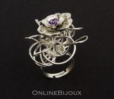 Inel handmade, placat cu argint 999. Pietre: cristale Swarovski. Culori: alb, verde, mov.