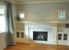 white glass marble tile fireplace. This looks very similar to our ...