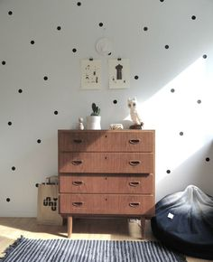 Polka dot wall idea-- instead of solid navy above the wainscoting, maybe white with navy polka dots (done with stencil)?