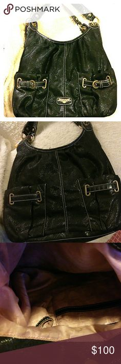 Kathy Van Zeeland handbags Beautiful handbag black pretty shiny 4 bags full pockets on the outside I can't tell you how many pockets on the inside there is a little bit of makeup on the bottom you could wipe it off it has been used Kathy Van Zeeland Bags Shoulder Bags