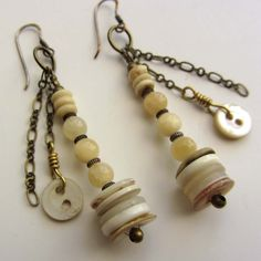 Earrings with vintage pearl buttons. $40.00, via Etsy.