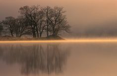 Sunrise over a misty Loch Achray in the Trossachs, Scotland. Photo by David May, via Flickr