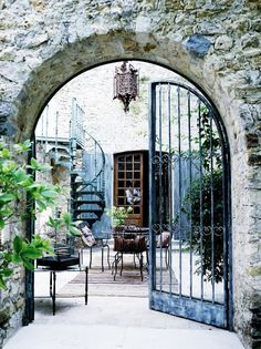 Oh my...iron gates. amazing courtyard. spiral staircase. 500 year old olive mill in Provence.   Photo credit: Mikkel Adsbøl