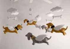 weiner dog mobile. $155.00, via Etsy. Would be easy if you have stuffed wiener dogs or a template for a forth of the price of that