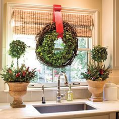 Don't Forget the Kitchen    The kitchen is where you spend most of your time during the holiday season. Spruce it up by hanging a wreath (or two) in your window. Stack two different kinds of wreaths together and hang with a single ribbon for an easy, layered look.