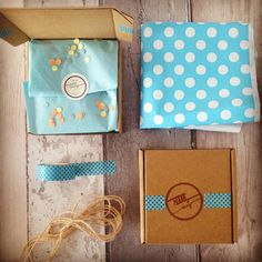 Brown kraft box, hand stamped logo, blue washi tape, blue polka dot envelope and a touch of confetti makes for some cute packaging!