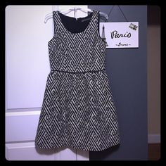 BR black & white pattern dress! 8 Never worn black and white pattern a line dress by Banana Republic. Faux leather trim on top and waist line. 16 chest flat, 14.5 waist flat. 36 inches long. Back zip. Banana Republic Dresses