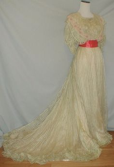 A stunning 1890's Bell Epoch area striped silk chiffon dress that has recently been de-accessioned from a museum collection. The cataloging tag and museum name is stitched inside the dress.