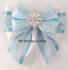 This Bow is Disney Inspired, Princess Elsa from the Movie Frozen. Blue and White Scroll Satin and Organza Princess Bow with a Beautiful