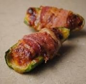 Baked Bacon Wrapped Jalapenos with Cream Cheese Stuffing.  OMG