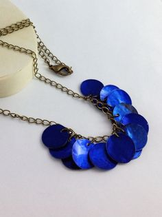 Blue seashell necklace. Long thin antique brass chain. Round cobalt blue shells. Handmade boho royal blue jewelry. I love the color! #teampinterest