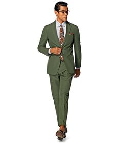 The Green Suit - You may think green is a little unconventional for tailoring, and you'd be right. But opting for a deep leafy tone over a bright apple shade will stop things feeling brash and ensure you stay the right side of refined. Keep everything else classic – tan brogues, a crisp white shirt, a subtly patterned tie are all the gentlemanly touches you need to pull off this modern masculine colourway. #menswear #summer #suit