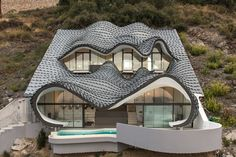 This ingenious home designed by GilBartolome Architecture showcases organic forms with zinc roofs extending out to the sea, located in Salobreña a town on the Granada coast, Spain. Aptly named 'Casa Acantilado' or 'cliff house', the structure was built to be respectful of its surrounding landscape.