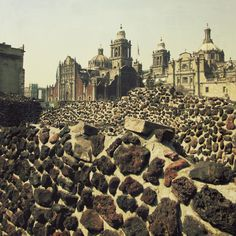 Here is the unearthed Templo Mayor (Major Temple) next to the Metropolitan Cathedral, Mexico City. This is the evidence of Catholicism taking over the Aztecs' Culture & becoming the main Religion. To this day, the Aztec Culture only remains in our history. The Templo Major Museum has dioramas, artifacts & the pyramids - one can walk on. Since these are in the middle of the city, the contrast leaves one with a vivid impression - specially when standing by the Sacrifices Chamber! By Gilda…