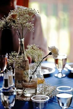 Lace, burlap and wispy babies breath.  White carnations are a symbol of pure love which is quite appropriate for a wedding.