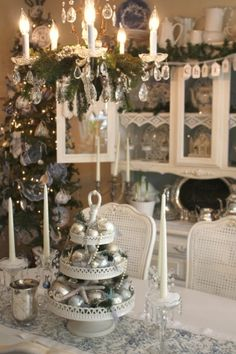 Cottage Christmas: This three-tiered centerpiece combines silver ornament balls, sparkling starfish, strands of jewelry and holiday greenery while adding a creative and vintage touch to a cottage-style dining room.~ I can do lace on hutch shelf! Shabby Chic Christmas Decorations, Christmas Table Centerpieces, Christmas Table Settings, Holiday Decor, Centerpiece Ideas, Silver Centerpiece, Holiday Dinner, Cottage Christmas, Noel Christmas