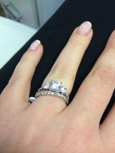 Trilogy ring, with a full diamond-set band White Gold & Diamond