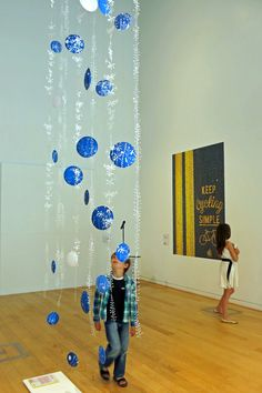art installation: laser cut paper plant forms and screen printed cyanotype paper pods by Josephine Gomersall designs