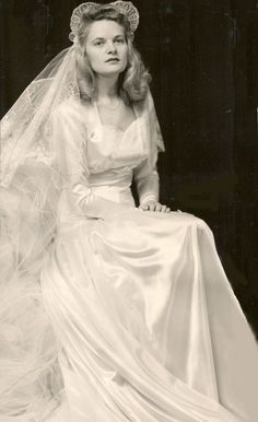 1940's bride. Note the classic 1940's sweetheart headpiece.