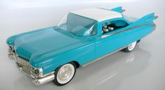 1959 Eldorado Biarritz Cadillac Telephone - TEAL  Two piece push button phone  Tone/Pulse switchable  Beep-beep horn ringer  Headlights flash when phone rings  Last number redial  Hearing aid compatible  $120.00