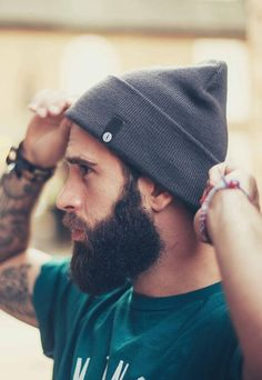 full thick dark beard and mustache beards bearded man men tattooed tattoos side shot profile photo
