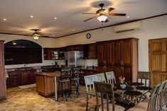 Your gourmet kitchen features stainless steel appliances, granite countertops, and top-of-the-line hardwood cabinets.