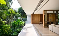 The architects' open-plan approach helps link the interiors to the leafy gardens and surrounding nature