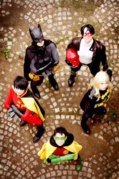clockwise from top left: Batman, Red Hood, Batgirl, Robin (Damian Wayne), & Robin (Tim Drake)