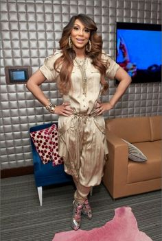 Tamar Braxton- love this gold jumpsuit & the silver Giuseppe heels