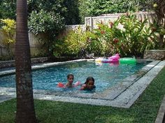 small swimming pools for small backyards - I like the rock ring around it as a barrier for dirt.