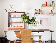 chic family-friendly home in florida on domino.com - loving the paper banner on the shelves