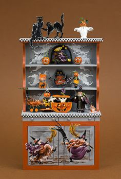 Good Sam Showcase of Miniatures: Halloween cupboard with hand-painted witches and ghosts.
