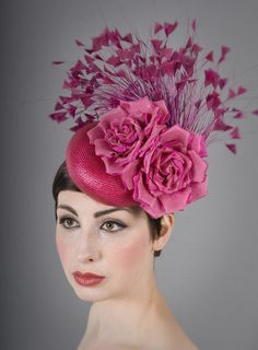 Tilt hat trimmed with silk roses and a feather spray | William Chambers Millinery | Spring/Summer 2014